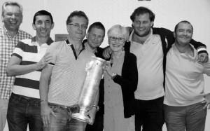 ACBL President Sharon Anderson presents the Spingold trophy to the winning team: Tor Helness, Franck Multon, captain Pierre Zimmermann, Geir Helgemo, Fulvio Fantoni and Claudio Nunes.