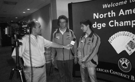 Univision's Pablo Herrera interviews Santiago Velez and Juan Felipe Cuervo of Colombia.